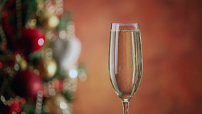 Pouring champagne and christmas tree stock video