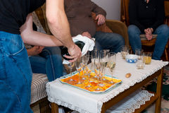 Pouring champagne at family celebration. Royalty Free Stock Photo