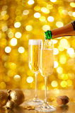 Pouring Champagne in a flute Stock Image