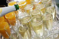 Pouring champagne into flutes Stock Photo