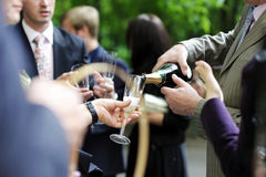 Pouring champagne into a glass Stock Photography