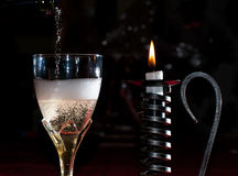 Pouring champagne in a glass Stock Photography