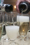 Pouring champagne in glass. Pouring champagne in crystal glasses Stock Images