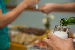 Pouring champagne into glass at hen-party, close up. Restaurant feed. New Year Christmas Royalty Free Stock Photos