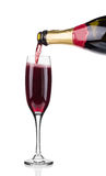 Pouring champagne in glass. Stock Image