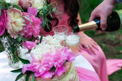 Pouring champagne into a glass on some festive event or wedding royalty free stock photo