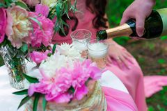 Pouring champagne into a glass on some festive event or wedding. Reception Stock Images