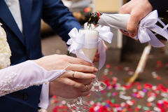 Pouring champagne into a glass Stock Photos