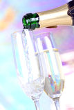 Pouring champagne in glasses Royalty Free Stock Image