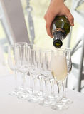 Pouring champagne, glasses. Alcohol, luxury event. Celebration Royalty Free Stock Photography