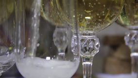 Pouring Champagne into glasses on the festive table stock footage