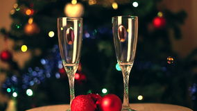 Pouring champagne into glasses stock footage