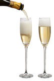 Pouring champagne. Sparkling in glasses Royalty Free Stock Photography