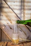 Pouring champagne into stemless glass royalty free stock photo