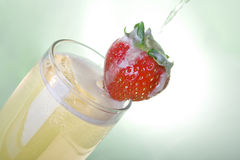 Pouring champagne with Strawberry Stock Photography