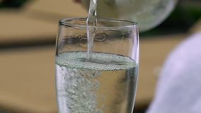 Pouring champagne to glass stock footage