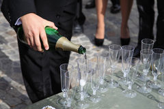 Pouring champagne to the glasses Royalty Free Stock Photos