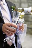 Pouring champagne to wineglass Stock Photos