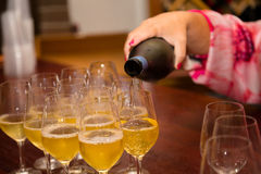 Pouring Champagne for Wedding Toasts Royalty Free Stock Images