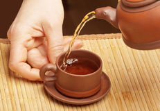 Pouring Chinese tea Royalty Free Stock Photo