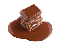 Pouring chocolate on chocolate bar Stock Images