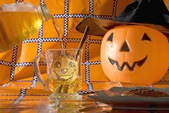Pouring cider on halloween