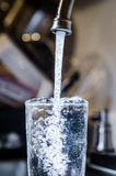 Pouring Clean safe drinking water from tap pipe home Stock Images