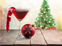 Glass with martini cocktail on festive background royalty free stock photography
