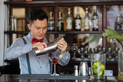 Pouring cocktail Stock Image