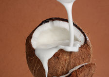 Pouring coco milk Stock Image