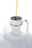 Pouring coffee. Isolated coffee cup with Pouring coffee Royalty Free Stock Photography