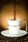 Pouring coffee. Isolated coffee cup with Pouring coffee Royalty Free Stock Photo