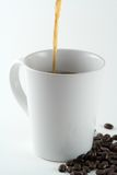 Pouring a Coffee. Coffee being poured into a mug Royalty Free Stock Photography