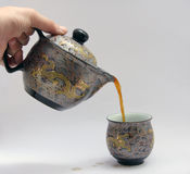 Pouring coffee. Into  a Chinese cup Stock Photos