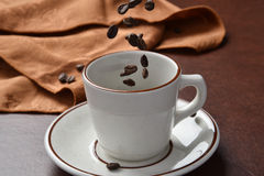 Pouring coffee beans Stock Photo