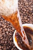 Pouring coffee and coffee-beans. Background Royalty Free Stock Image