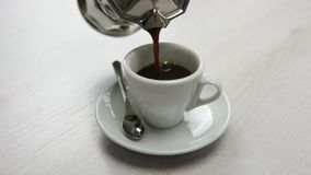 Pouring coffee with coffee pot stock footage