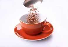 Pouring coffee in cup Royalty Free Stock Photography