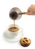 Pouring coffee in cup. On white Stock Images