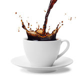 Pouring coffee. Pouring a cup of black coffee creating splash Royalty Free Stock Photos