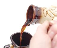 Pouring coffee in cup from  cezve Royalty Free Stock Images