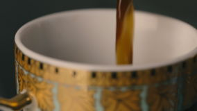 Pouring coffee in cup. Pouring hot turkish coffee in white cup stock footage