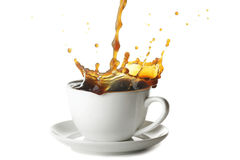 Pouring coffee in cup Royalty Free Stock Photos