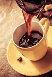 Pouring coffee in cup Stock Image