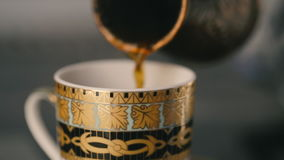 Pouring coffee in cup. Pouring coffee in white cup stock footage