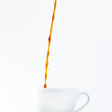 Pouring coffee in a cup on white background. Breakfast. Stock Images