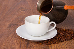 Pouring coffee in cup Stock Photography