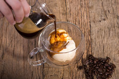 Pouring Coffee Espresso into the vanilla Ice Cream in a doubled Stock Photos