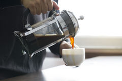 Pouring coffee from French press coffee maker Royalty Free Stock Photo