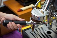 Pouring from coffee machine Royalty Free Stock Images